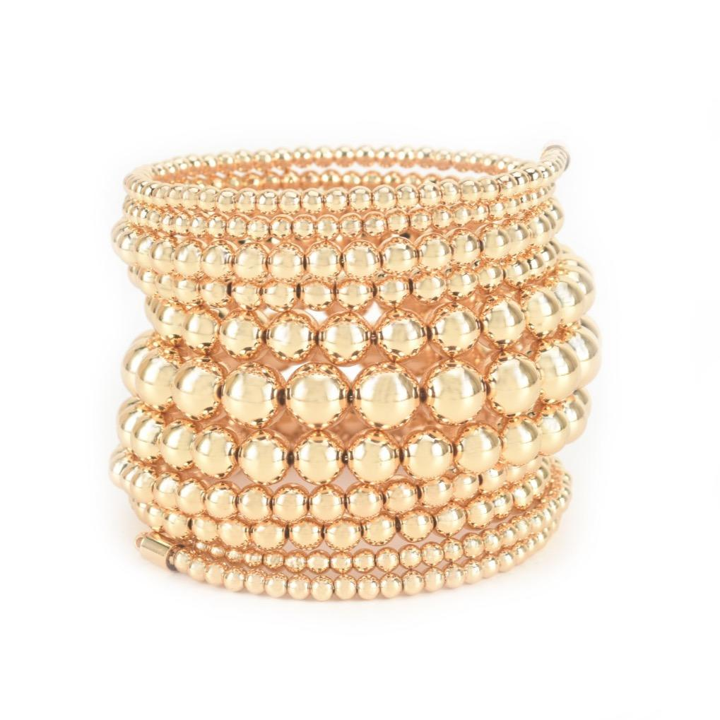 Eleven rows of gold beads make up this super stacked bracelet in gold