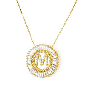 Radiant Initial Necklace. A crystal initial surrounded by radiating crystals on a gold chain.