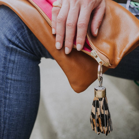 The Stella Foldover Clutch in brown leather with tassel