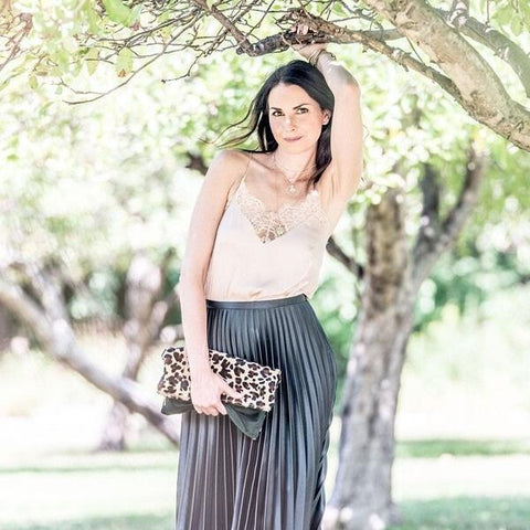 fashionable woman holding Green Velvet Leopard Clutch