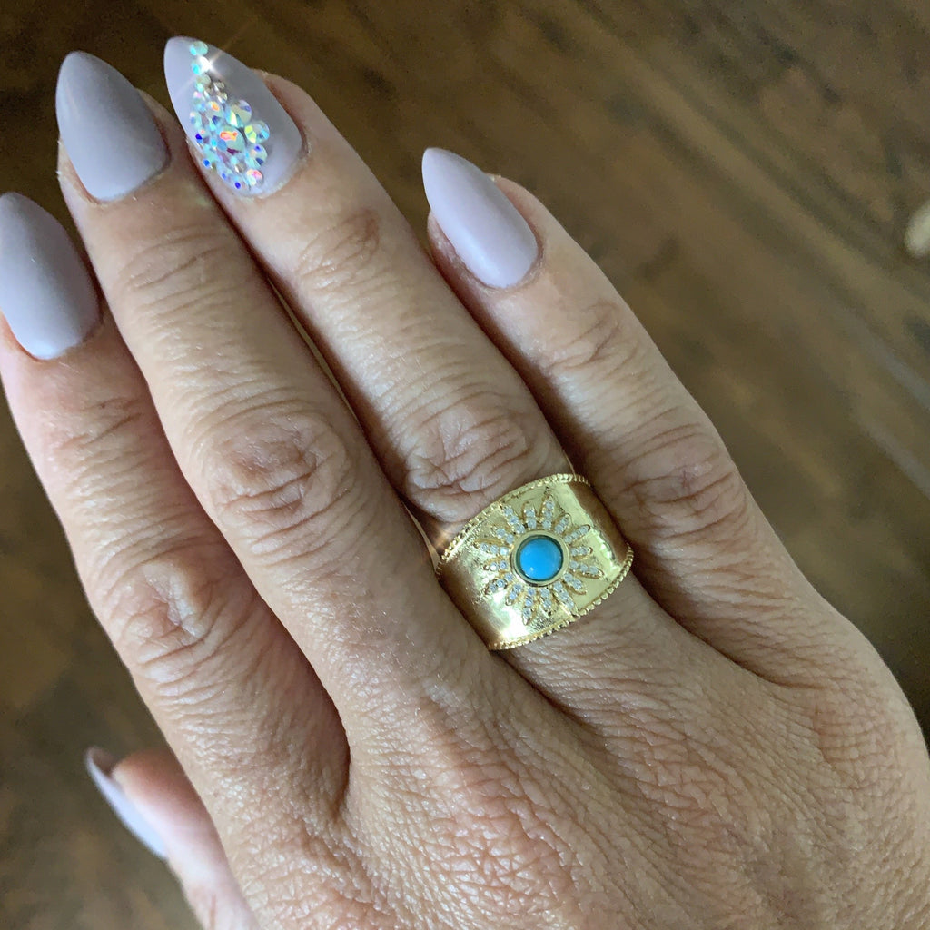 Gold Ring with Blue Stone and Crystal Starburst.
