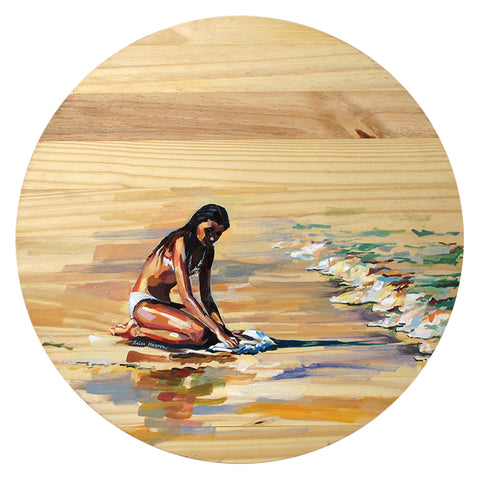 Circular painting on exposed wood of a woman kneeling near the shore