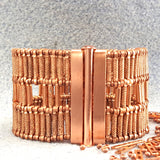 Photo of a broad copper bracelet clasp