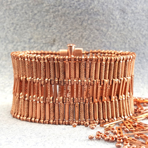 Photograph of wide copper bracelet