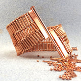 Photograph of wide copper bracelet unclasped