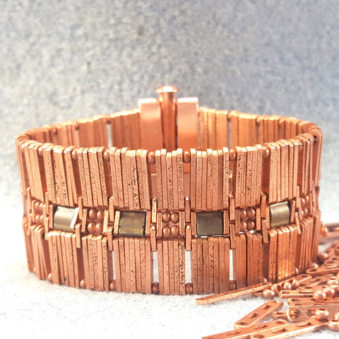 Very wide copper bracelet with ornate middle row