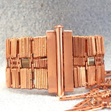 Very wide copper bracelet with ornate middle row with clasp