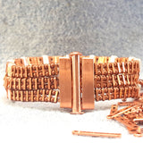 Copper bracelet with three rows of rectangular green stones with clasp
