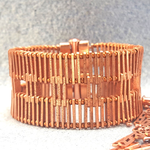 Photo of a broad copper bracelet