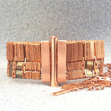 Wide copper bracelet with clasp