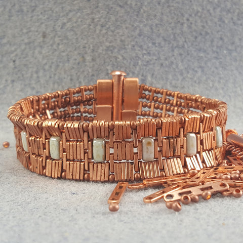 Copper bracelet with one row of rectangular green stones