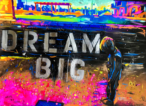 "Vibrant colors with pinks, oranges, blues, yellows, of boy looking down with ""DREAM BIG"" written out in stencil"