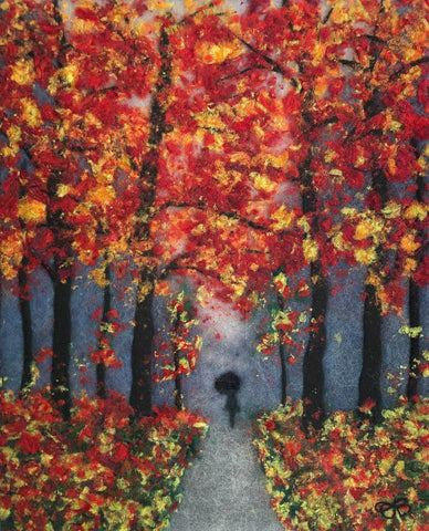 Pressed wool and silk fibers of a silouette of a person walking in an autumn woods with leaves of yellows and reds