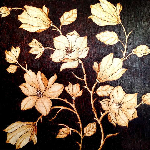 Drawing of magnolias burned on a square panel