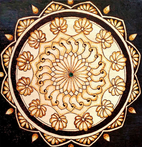 Drawing of a decorative circular design burned on wood panel