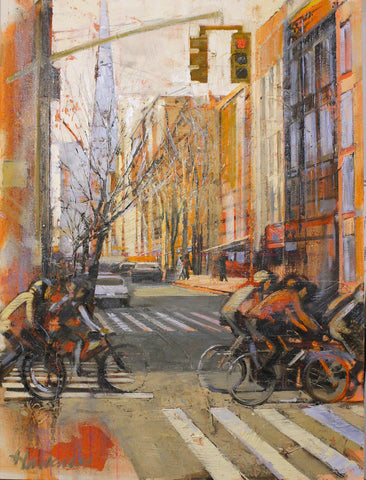 Warm and colorful street scene with bicyclists crossing a city street intersection