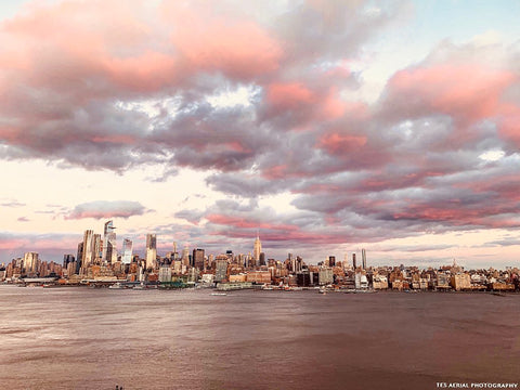 Puffy pink clouds loom over the New York City skyline