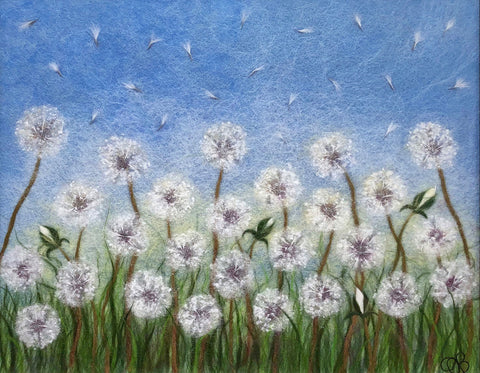 "Fibers make up a row of dandelion blowballs in green grass under a blue sky; signed in lower right-hand corner ""OB"""