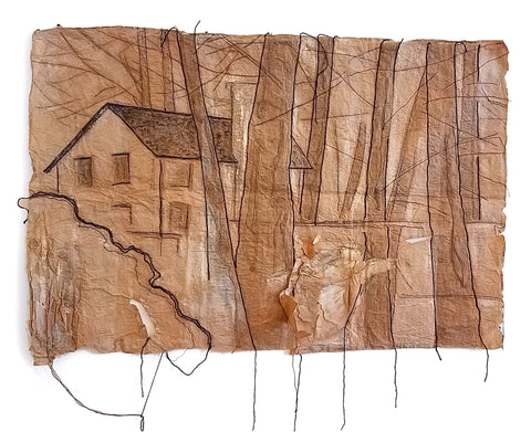 Image of trees and a house emerge from threads on a roughly edged brown paper backing with threads hanging at bottom