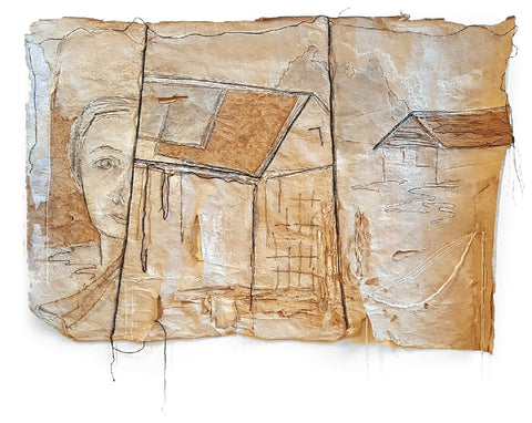 Dark string is used to draw half a face on the left with two houses on brown paper with raw edges