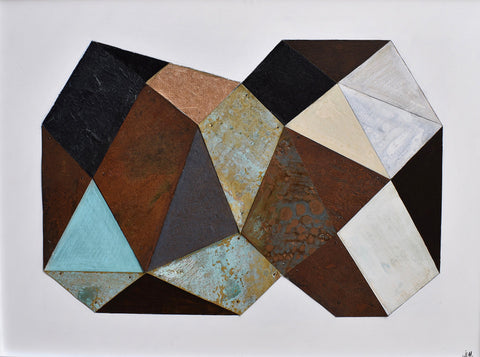 Glodule of geometric shapes in warm rusts and golds as well as blacks and grays on flat gray background