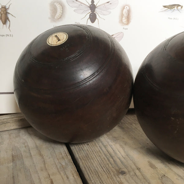 Pair of 1930s decorative lawn boules bowls