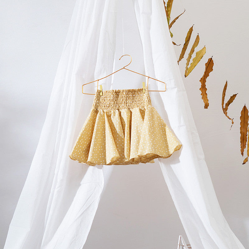 A flouncy full circle skirt. Made with sustainably grown cotton fabric and herbal dye. Perfect for the summer playtimes