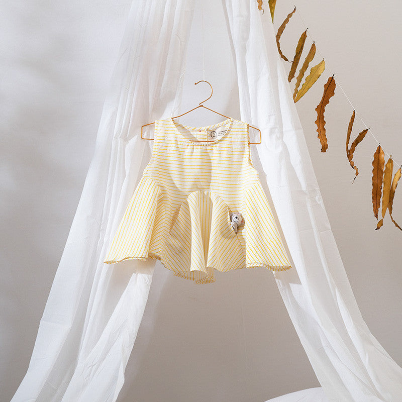 Stylishly cut flared top with invisible pockets for your little one to hide her precious treasures in. Made with soft khadi, Azo free dyes with natural shell buttons at the back. Perfect for vintage weddings.