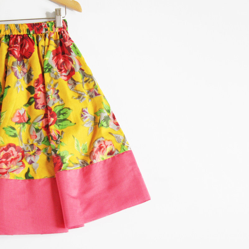 Nothing says summer like a bright girls floral dress. Lightweight cotton girls lehenga with elasticated waist for extra comfort, combined with a green chanderi halter top with adjustable tie fitting. Chiffon dupatta with gold border. A perfect indian wedding outfit