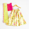 This indian lehenga choli floral dress for girls comes in a contemporary print design and screams out summer for weddings. Bright pink top with yellow piping and gold button design shows elegance whilst the chiffon dupatta with pom pom fringe adds contrast to this indian wedding dress for girls