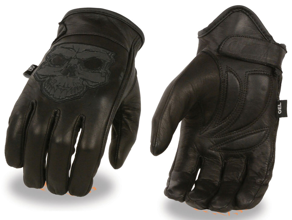 Leather motorcycle riding gloves with reflective skull pictured on back of hand. They are available in sizes XS-3X and have a thermal lining and velcro wrist closure. They are available in our shop just outside Nashville in Smyrna, TN.