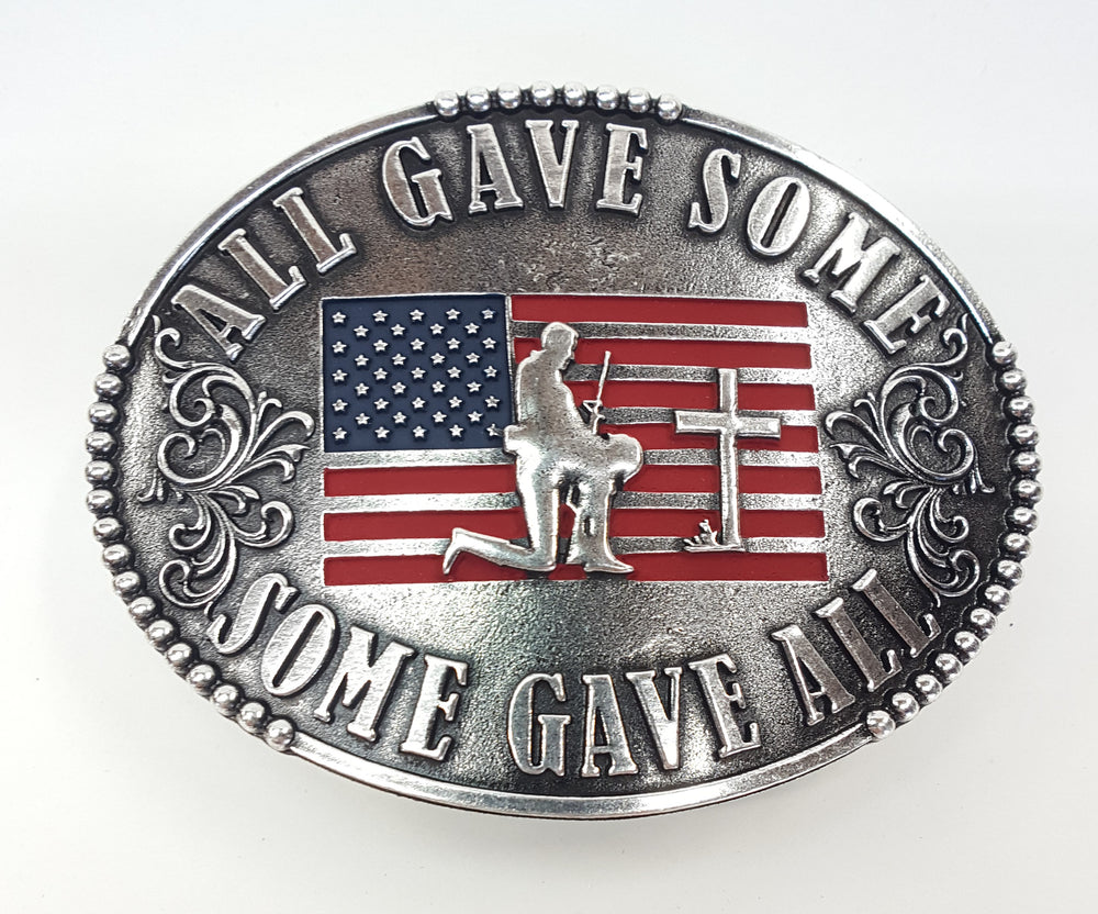 "All Gave Some Some Gave All Buckle oval plate style belt buckle with American Flag inlay under kneeling soldier and cross. All Gave Some, Some Gave All imprinted around edges of buckle and scroll design on either side of wording. Available in our shop just outside Nashville in Smyrna, TN as well as on this website.  Made by AndWest in Mexico. Dimensions are 3 1/4"" by 4 1/4"". Another view of front of buckle."