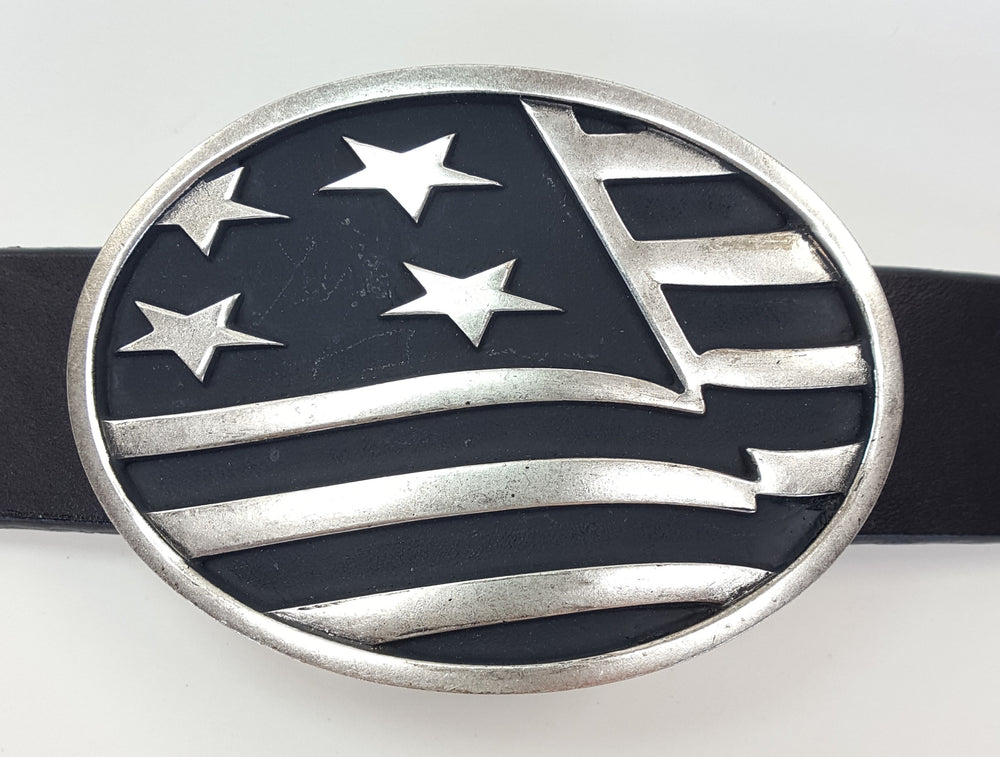 "AndWest Close Up Flag Buckle, oval shaped with close up black and silver view of the American flag pictured. Fits belts from 1 1/4"" to 1 1/2"" wide. Available in this online store as well as in our shop in Smyrna, TN, just outside Nashville. Pictured on black leather belt"