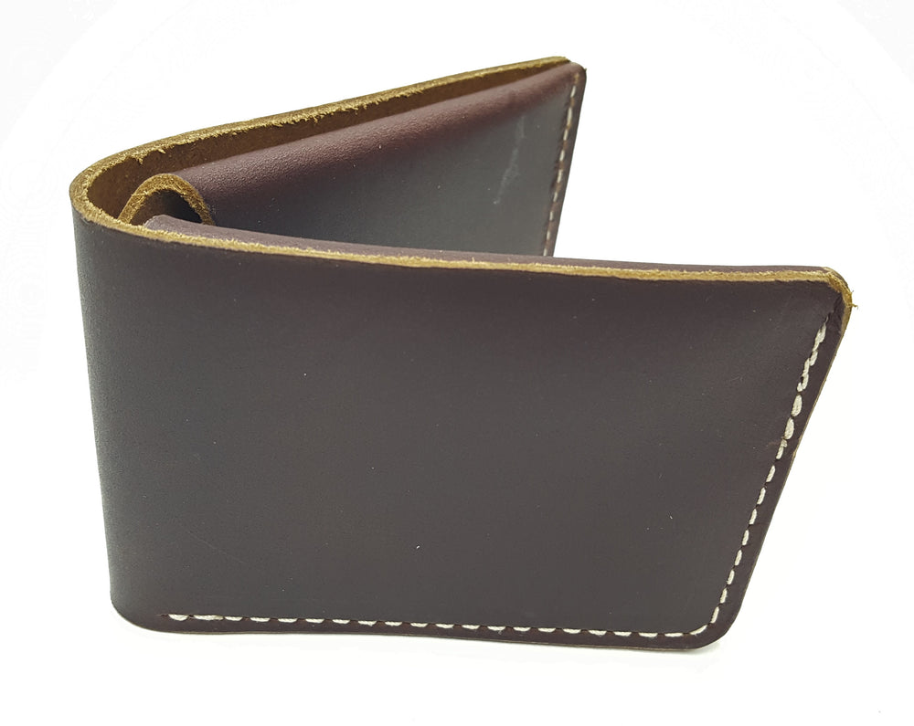 Brown Leather Card and bill bi-fold wallet with raw leather edges and white stitching around edges.  Inner wallet has pocket for cards on either side of the fold with a cash pocket along the entire back side.  Made just outside Nashville in Smyrna, TN