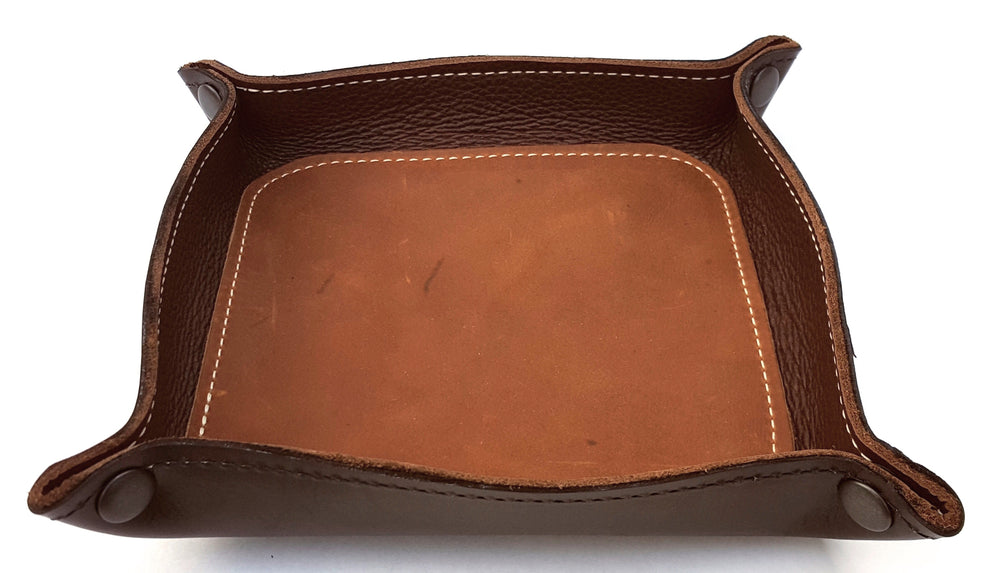 "Handmade Leather Snap Valet Tray with black exterior, dark brown interior and light brown center inlay.  Made from 3 pieces of real leather, glued and stitched in place.  Corners are snapped together so it may flattened for travel. Inside dimensions are approx 7"" across. Made just outside Nashville in Smyrna, TN."