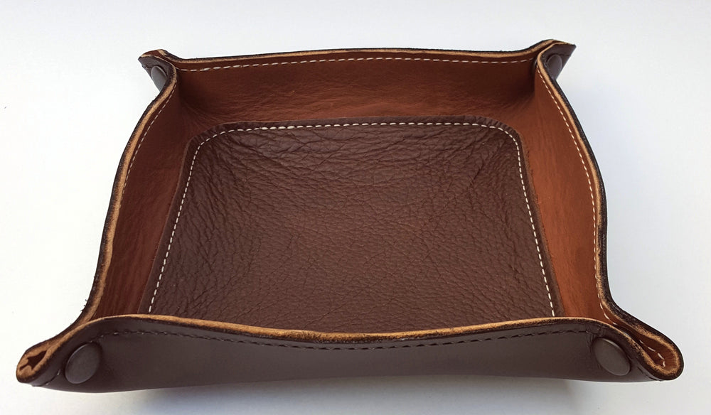 Handmade Leather Snap Valet Tray with black exterior, medium brown interior and dark brown center inlay.  Made from 3 pieces of real leather, glued and stitched in place.  Corners are snapped together so it may flattened for travel.  Made just outside Nashville in Smyrna, TN.
