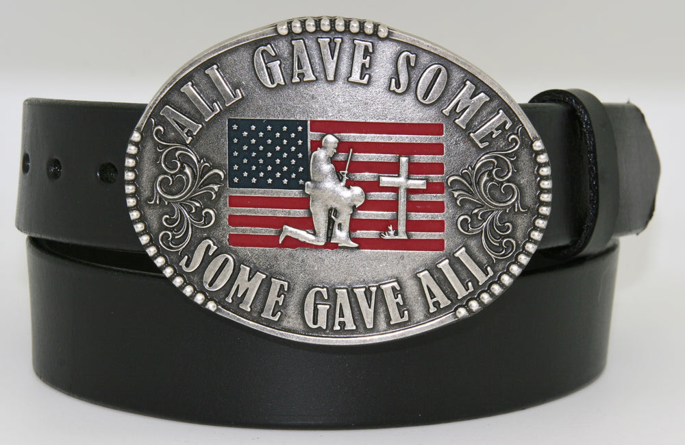 "All Gave Some Some Gave All Buckle oval plate style belt buckle with American Flag inlay under kneeling soldier and cross. All Gave Some, Some Gave All imprinted around edges of buckle and scroll design on either side of wording. Available in our shop just outside Nashville in Smyrna, TN as well as on this website.  Made by AndWest in Mexico. Dimensions are 3 1/4"" by 4 1/4"", pictured on sturdy black leather belt, also available from this shop."