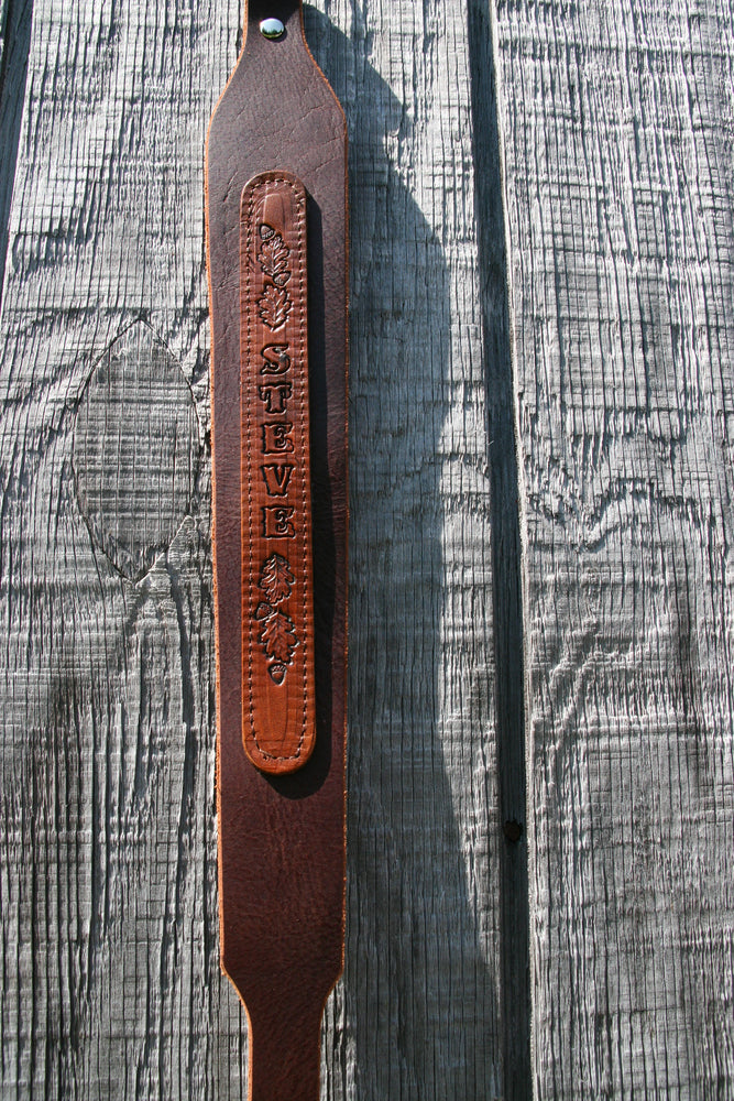 Rifle sling with stitched name plate
