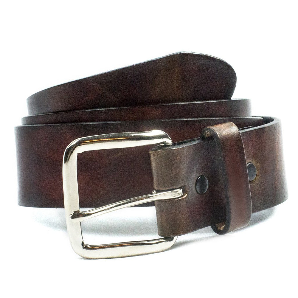 "This USA made veg-tan leather belt is approx. 1/8"" thick, 1 1/2""width with no fillers to split or rip apart. The belt is a solid hand finished with NO embossing. The leather is comfortable from day one. Buckle is snapped on for easy buckle change. We don't make this belt but it's Buckle and Hide approved and still made in the USA. Be very sure of your size since it is NON returnable since we custom size each one, see below instructions. front view"