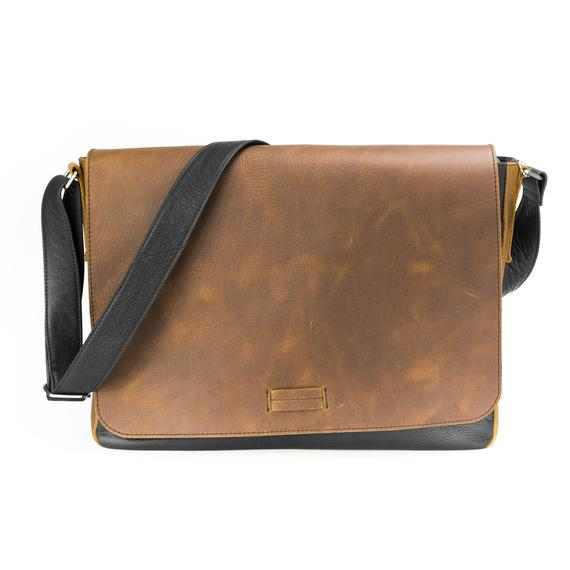 "Leather Messenger Bag with distressed brown leather flap and plain leather contrasting sides.  Back pocket holds full sized laptop.  Hardware has brushed nickel finish.  Flap snaps closed with magnetic clasp.  Dimensions are approx 15"" by 12"" by 3"". Available in our retail shop in Smyrna, TN, just outside Nashville"