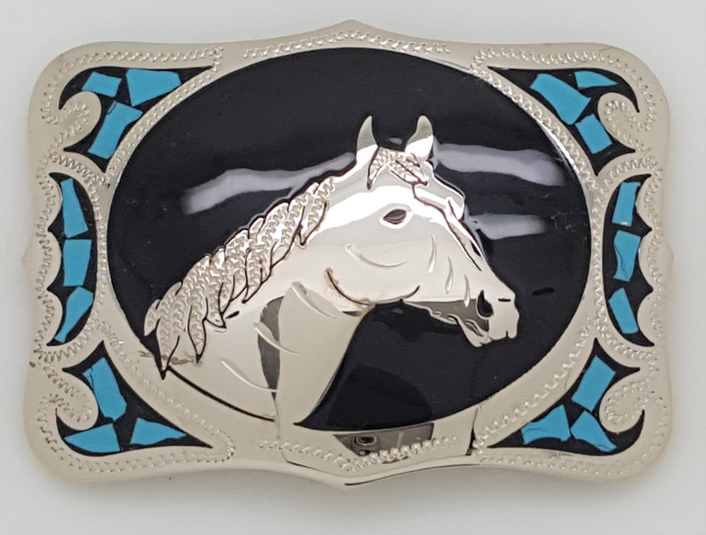 "Colorado Silver Star Horse Head buckle-Colorado Silver Star Horse Head Buckle Beautiful Silver colored rectangular buckle has horse head pictured in center surrounded by black epoxy background. Turquoise colored stone pieces  add color and decoration to each side front of buckle. Made in USA Fits belts up to 1 1/2"" wide. Available in our online shop and in the retail store in Smyrna, TN, just outside Nashville."