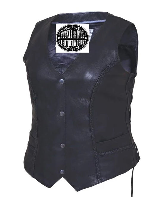 Ladies black soft cowhide leather vest with v-neck and snap front closure. It has solid sides and 2 outside front pockets. It has multi paneled back with braid accents and side laces.  Available for purchase in our shop in Smyrna, TN, just outside Nashville.  Available in sizes XS-5X.