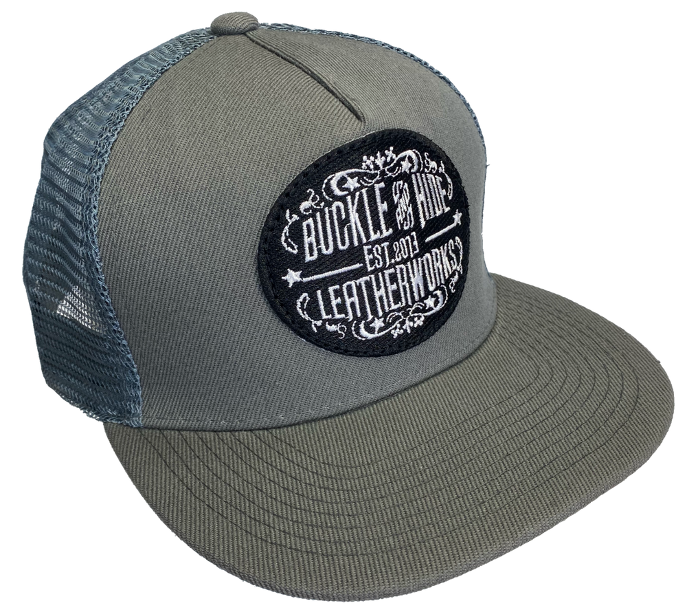Official Buckle and Hide merchandise for your favorite leather shop just outside Nashville in Smyrna, TN Classic style cap with Buckle and Hide patch sewn on the front Snap Back Structured top Currently available in Gray.