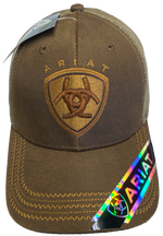 Brown Trucker cap with tan mesh back and velcro closure. Structured front has Ariat logo embroidered. Available at our shop just outside Nashville in Smyrna, TN.