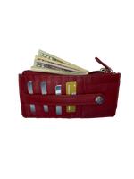 Ladies long style wallet with 9 card slots with security snap strap 2 zippered pocket and I.D. cash pocket. stocked in 3 Red, Black, Tan. Imported, Great Value, and Buckle and Hide approved!