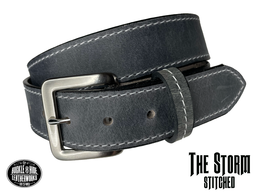 "This gray leather belt is made from Crazy Horse tanned leather for that distressed and pull-up look. Choose with or without white stitching along the edges.  Has smooth black painted edges. It has an antique solid brass buckle that is snapped in place. Belt is 1 1/2"" wide and available in lengths from 34"" to 44"".  It is handmade in our shop in Smyrna, TN, just outside of Nashville."