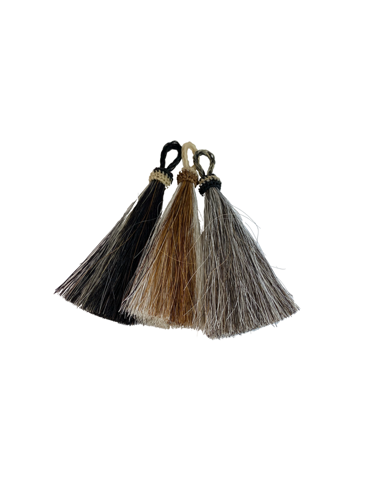 Bundled Horse Hair with loop to attach to Key Ring.