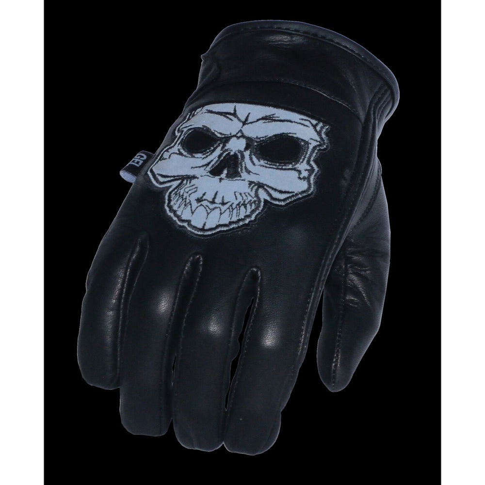 Night time reflective view of Leather motorcycle riding gloves with reflective skull pictured on back of hand. They are available in sizes XS-3X and have a thermal lining and velcro wrist closure. They are available in our shop just outside Nashville in Smyrna, TN.