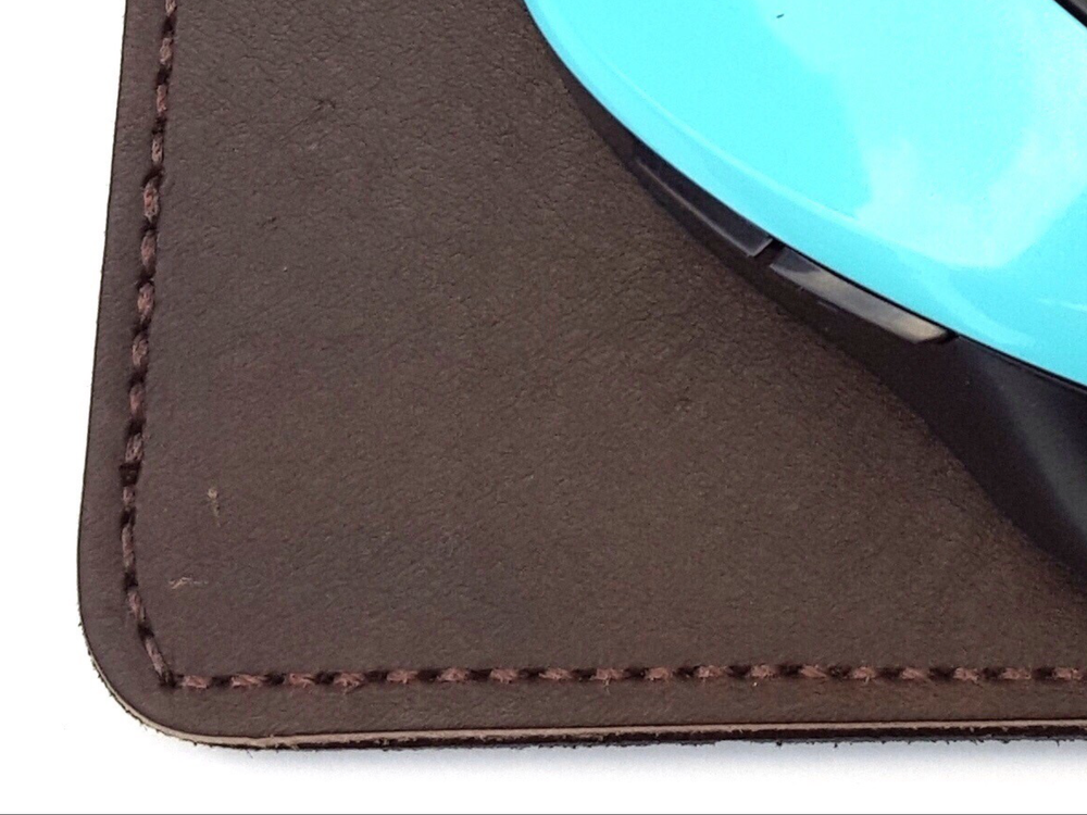 "Deluxe Leather Mouse Pad, This handmade leather mouse pad has brown leather topside and black suede leather bottom to help prevent slipping of pad on surface.  It is made from leather approx 1/8"" thick and suede is glued and stitched in place. This is close up view of stitched edge.  Size is approx 7 1/2"" x 7 3/4"". Made in our shop just outside Nashville in Smyrna, TN."