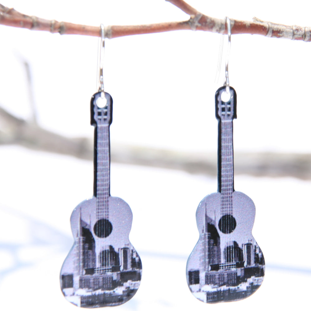 Nashville Guitar Earrings Black and White Black and white version of Nashville skyline earrings, we took this picture of downtown Nashville in February 2016.  We are the only vendors for these earrings! They have Non-tarnishing silver ear wires. Made in USA.